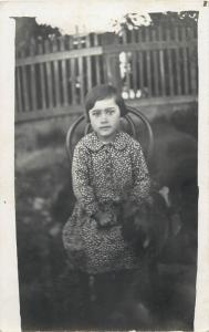 Vintage children topic photo postcard cute girl sitting on a chair