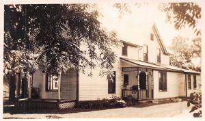 VICTORIAN HOUSE WITH ORNATE TRIM~PORCHES REAL PHOTO POSTCARD 1900s