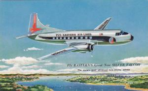 EASTYERN Air Lines Silver Falcon prop airplane in flight , 50s