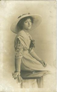 Woman sitting, early 1900s used real photo Postcard