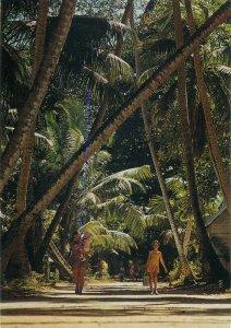 SEychelles village road on La Digue Island postcard