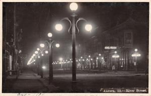 Aurora IL 3-Globe Lampposts~Edelweiss Sign~Abandoned River St @ Nite RPPC c1914