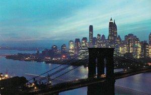 USA New York City Nightfall in lower Manhattan with Brooklyn Bridge 03.80