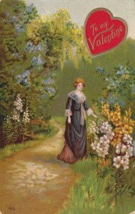 VALENTINE'S DAY, PU-1910; Woman admiring the flowers alongside the road