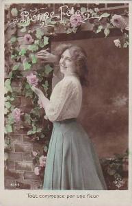RP; Hand-tinted, Bonne Fete, Tout commerce par une fleur, Woman leaning on br...