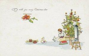 CHRISTMAS, 1900-10s; Women decorating tree, Toys, Poinsettia