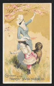 VICTORIAN TRADE CARD Domestic Sewing Co Fancy Dressed Mom Girl at Tree with Dog