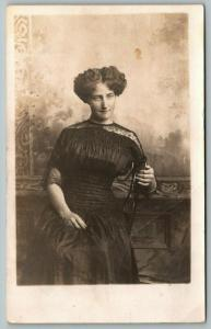Bronson MN~Marie Parts Curly Hair in Middle~Good Times We Use to Have~RPPC 1911