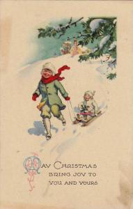 May Christmas bring joy to you and yours, Boy pulling girl on sled in the sno...