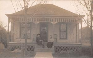 RPPC Older Couple on Porch of Modest Home w/Fancy Porch~Lattice Work~RPPC c1910
