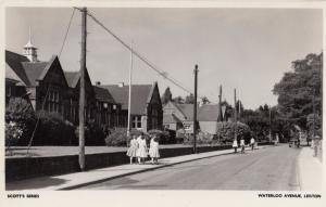 Schoolgirls On Waterloo Avenue Leiston by Suffolk Cyclists Real Photo Postcard