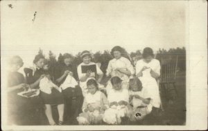 Group of Girls Children Sewing & Reading c1910 Real Photo Postcard