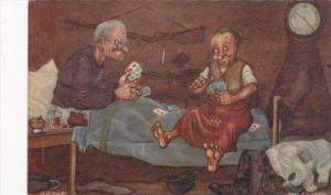 Old Couple Playing Cards In Bed