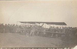 RP; WAPELLO, Iowa, 1911; Bud Mars getting biplane ready for flight