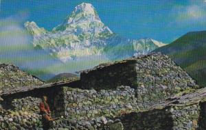 Lady sitting on stone wall, Ama Dablam Mountain, Nepal, Himalayas, 1970-80's