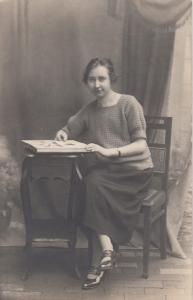 RP: Woman Posing with a postcard album , 00-10s