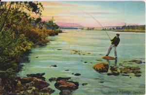 SWEDEN - YOUNG BOY SALMON FISHING ... on wide river with large bridge - 1910s