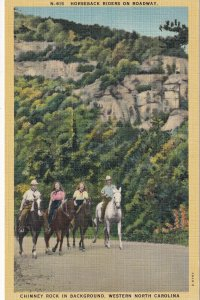 NORTH CAROLINA, 1930-1940s; Horseback Riders On Roadway, Chimney Rock