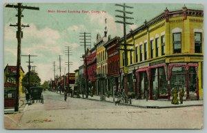 Corry PA~Main Street~Corner Drug Store~Arlington Hotel~Edwards Barber Shop~1910