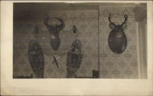 Taxidermy - Mounted Deer Heads & Snowshoes on Wall Real Photo Postcard