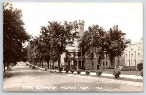 Anamosa Iowa~1920s Cars Parked on Road by State Reformatory~Battlements RPPC PC