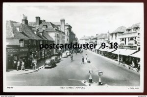 dc1703 - ENGLAND Ashford 1940s High Street. Stores. Old Cars. Real Photo PC