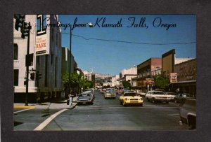 OR Greetings From Klamath Falls Oregon Postcard First National Bank 7 UP Tavern