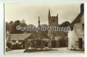 tp8919 - Wilts - Market Cross and the Church, in Castle Combe Village - Postcard