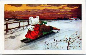 Christmas postcard - Children on sled in country