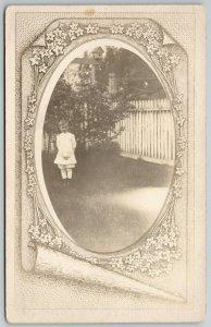 RPPC~Little Tyke~White Picket Fence~Mask~Art Nouveau Flowers~Scroll~c1910