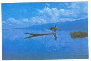 Fisherman Rowing With His Leg-A Unique Feature Of Life On The Onle Lake, Burm...