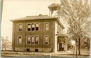 FREDERICKSBURG, Iowa RPPC Real Photo Postcard HIGH SCHOOL Street View c1910s