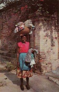 JAMAICA , 1950-60s; Woman selling Yard Goods
