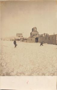 F35/ Garwin Iowa RPPC Postcard c1910 Snow Elevators Railroad