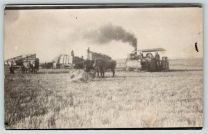 Victoria KS~Newlywed Albert Devore Runs Engine~Thrasher Bundles Grain~RPPC 1914