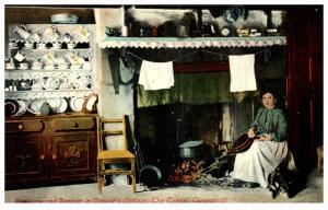 Irish Woman   Connor's Cottage Interior Woman stoking fire