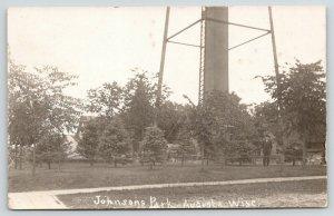 Augusta Wisconsin~Johnson's Park~Man Standing Below Water Tower~c1912 RPPC