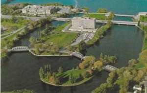 Ottawa City sitting in a park-like area in the mouth of the Rideau River, OTT...