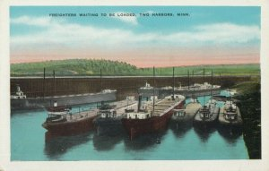 TWO HARBORS , Minnesota, 1910s ; Freighters waiting to be loaded