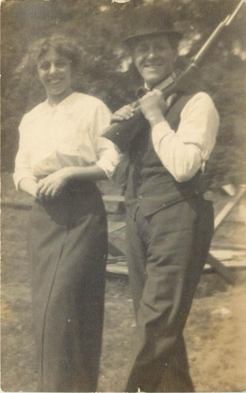 c1910 Real Photo Postcard; Smiling Woman & Man with Derby Hat & Rifle, Unposted