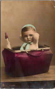 RARE - POSTCARD ADDRESSED to  Dr. Ida Heiberger - Baby in a purse - POSTED RPPC
