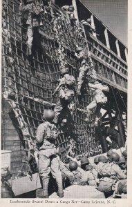 CAMP LEJEUNE, North Carolina, 1900-1910's; Leathernecks Swarm Down A Cargo Net