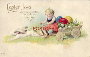 embossed EASTER JOYS and sweet content be with you this day Young girl on wagon