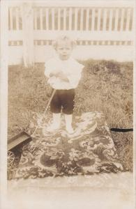 RP; Little boy playing with toy wagon in backyard, 20-30s