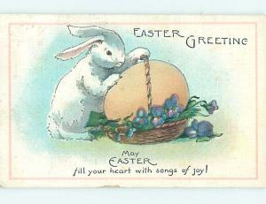 1934 Easter BUNNY RABBIT TRIES TO CARRY GIANT EGG IN BASKET o6107