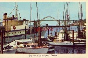 NEWPORT, OR Fishing fleet in YAQUINA BAY, Newport Harbor, showing Newport Bridge