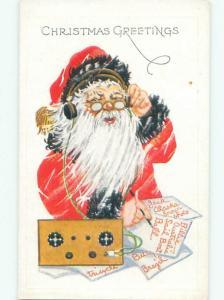 Pre-Linen Christmas SANTA CLAUS USING ANTIQUE RADIO AND HEADPHONES AB4861