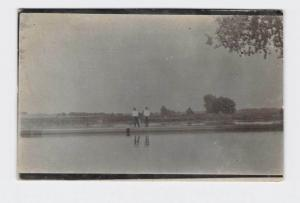 RPPC REAL PHOTO POSTCARD MEN STANDING ON BANK OF RIVER