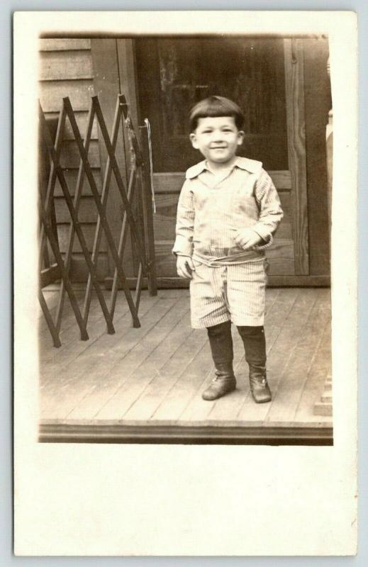 RPPC~Young Boy Gets Past Baby Gate & Anticipates His Backyard Escape ~c1917 PC