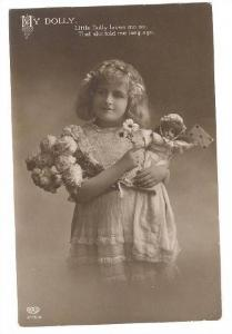 RP; Girl holding doll and bouquet of flowers, My Dolly. Little Dolly loves me...